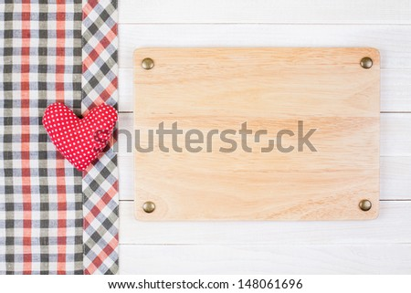 Sign board, tablecloth, heart on white wood background - stock photo