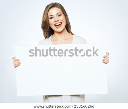 Sign board. Woman holding big white blank card. Positive emotional portrait of happy girl with long hair. - stock photo