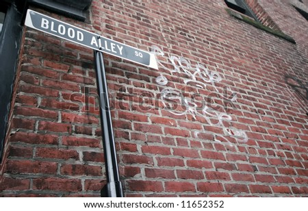 Sign by a brick wall - stock photo