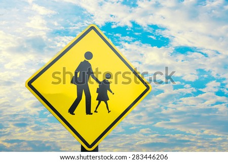 Sign close to school wait for kid cross the road with blue sky - stock photo