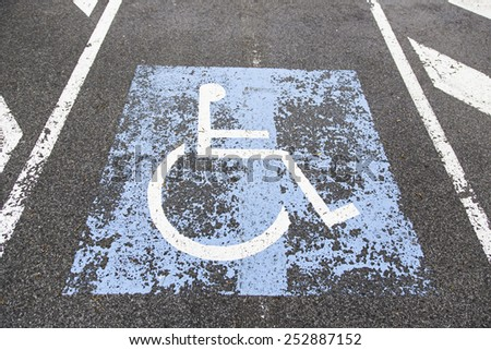 Sign disabled, detail of a signal in a parking support - stock photo