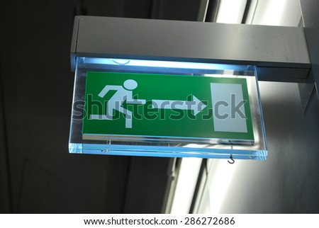 Sign emergency exit - stock photo