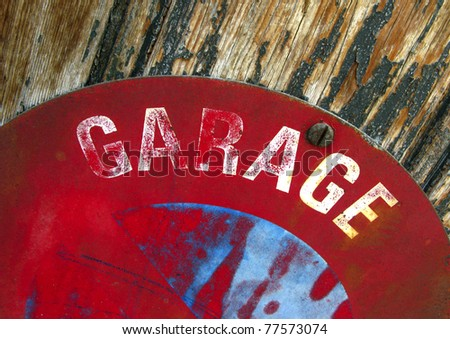 Sign for a garage on a door