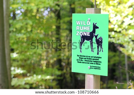 sign for animal protection in a forest - stock photo