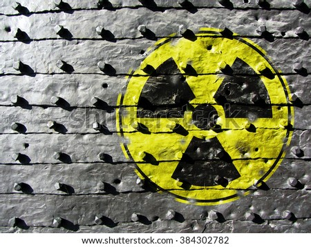 Sign for Radioactivity on a cast iron texture - stock photo