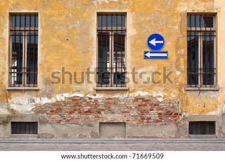 sign go left on old wall - stock photo