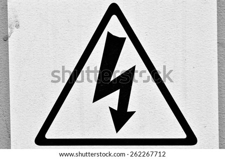 Sign 'High voltage' on the transformer, Black and white photo. - stock photo