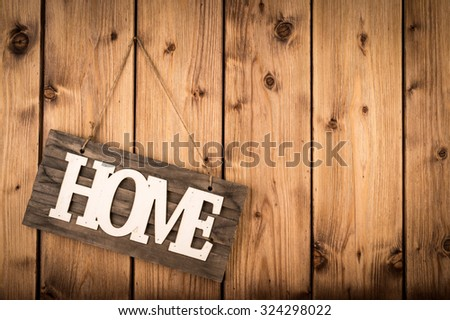 Sign HOME on the wooden wall.