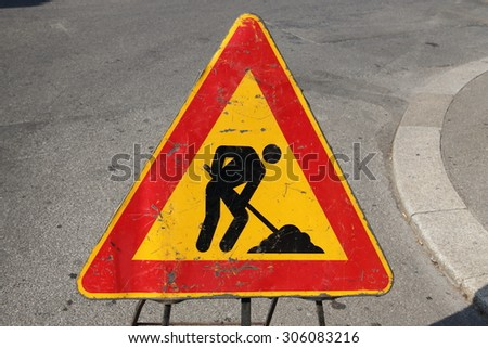 Sign informing about the work on the road  - stock photo