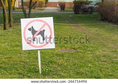 Sign informing that dogs are not allowed - stock photo