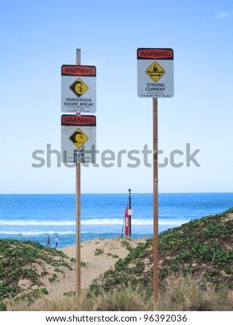 sign is warning of dangerous shore break - stock photo
