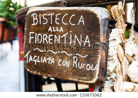 Sign made of wood with Bistecca alla Fiorentina (Florence steak) words - stock photo