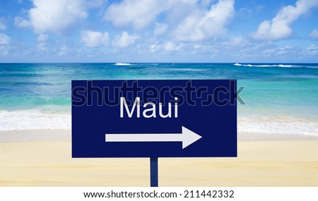 """Sign """"Maui"""" on a beach by the water in sunny day - stock photo"""