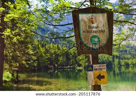 sign, nature reserve, langbathsee, salzkammergut, austria - stock photo