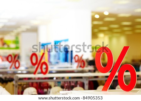Sign of discount in clothing department during sale
