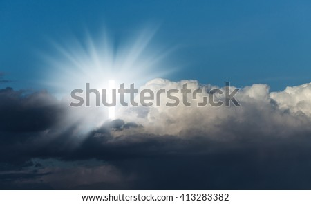 Sign of faith. Glowing holy cross in the blue  sky with white clouds - stock photo