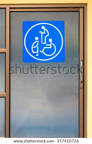 Sign of oldster, expectant mother and cripple on toilet door
