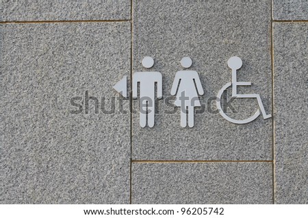 Sign of public toilets WC on cement background - stock photo