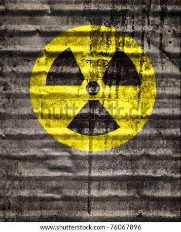 sign of radiation, nuclear warning on grunge metal texture background - stock photo