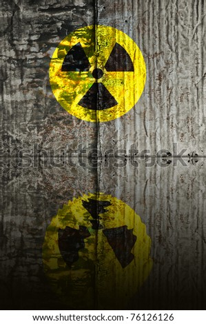 sign of radiation, nuclear warning on grunge metal texture background with reflection - stock photo
