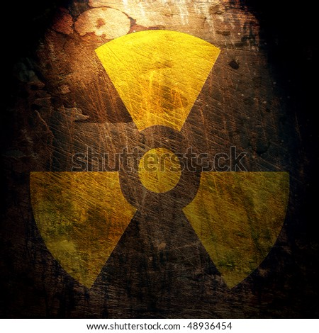 sign of radiation on the grunge wall - stock photo