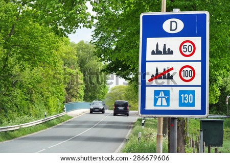 Sign of Speed limits at the German border  - stock photo