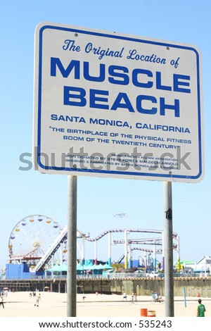 """Sign on the beach declairing """"Muscle Beach"""" - stock photo"""