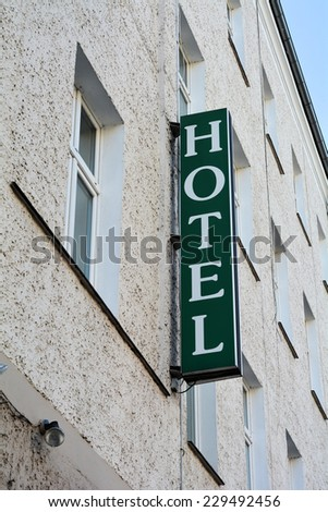 sign on the facade of a hotel in Berlin - stock photo