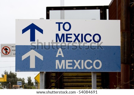 Sign pointing the way to Mexico from Arizona - stock photo