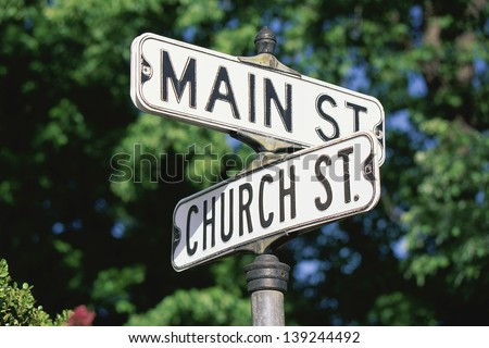 Sign post at the corner of Main St. and Church St. - stock photo