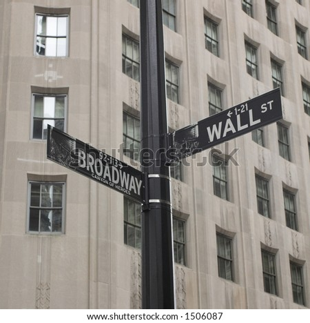 Sign post between broadway and wall street - stock photo