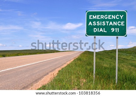 Sign reminding motorists of the emergency number 911. - stock photo