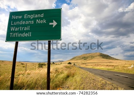 Sign road on the Garden Road in South Africa with heavy sky - stock photo