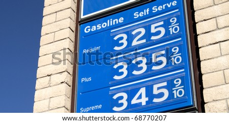 Sign showing high price of gasoline in the USA starting to rise - stock photo
