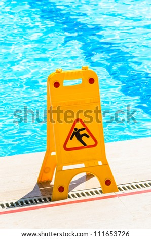"Sign ""slippery floor"" by the pool - stock photo"