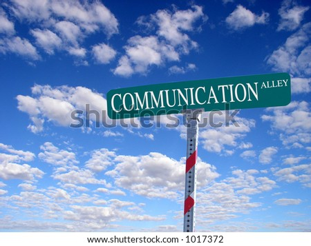 "sign that reads ""Communication Alley"" - stock photo"