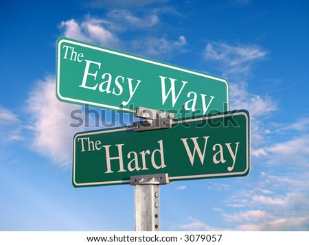 "sign that reads ""Easy Way, Hard Way"" - stock photo"
