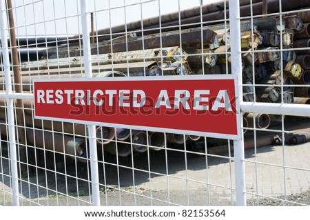 Sign that tell this is a Restricted Area - stock photo