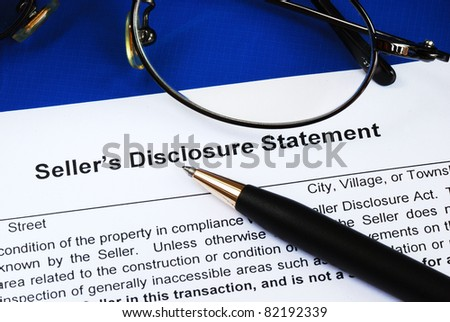 Sign the seller disclosure statement in a real estate transaction - stock photo