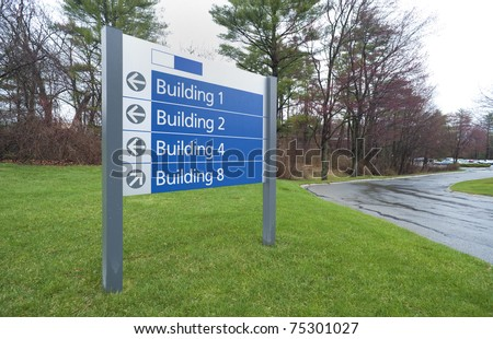 Sign to office buildings complex in industrial park - stock photo