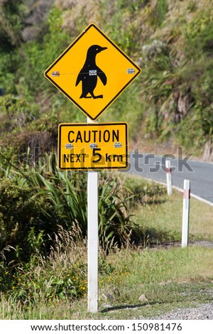 Sign to warn drivers of crossing penguins. South Island of New Zealand. - stock photo