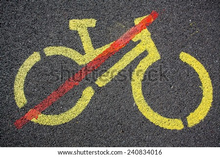 Sign with restriction of cycling painted on a tarmac road - stock photo