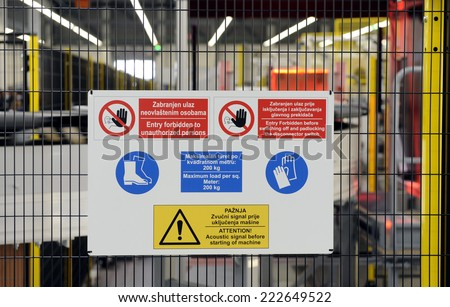 sign with safety notices in factory - stock photo