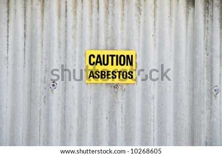 Sign with text: Caution asbestos - stock photo