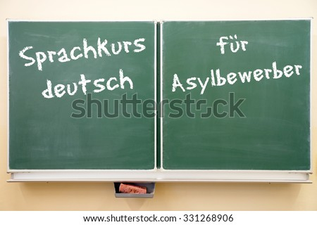 Sign with the german words German language course for asylum seekers / German language course - stock photo