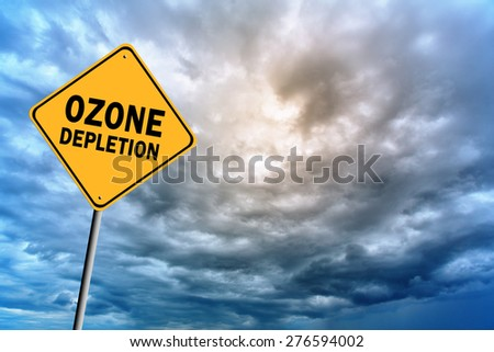 Sign with words 'Ozone depletion' on a background of thunderclouds in cold tones