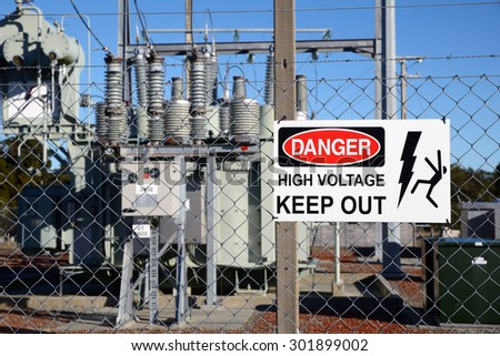 Signage warns people against accessing an electrical sub-station - stock photo
