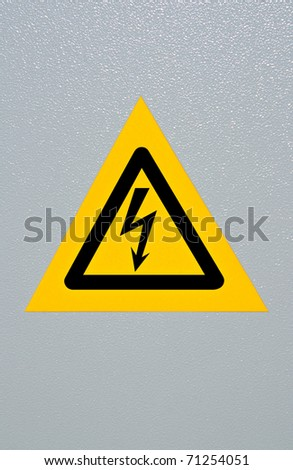 Signal of danger of electrocution from high voltage isolated in grey - stock photo
