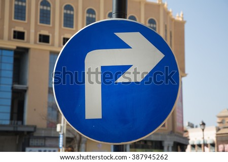 Signal turn right on road, Traffic Signs,traffic signs on road in China - stock photo
