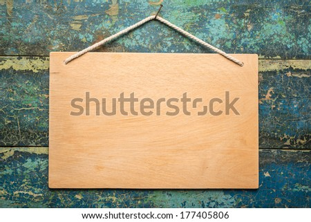 Signboard on the old wooden background   - stock photo